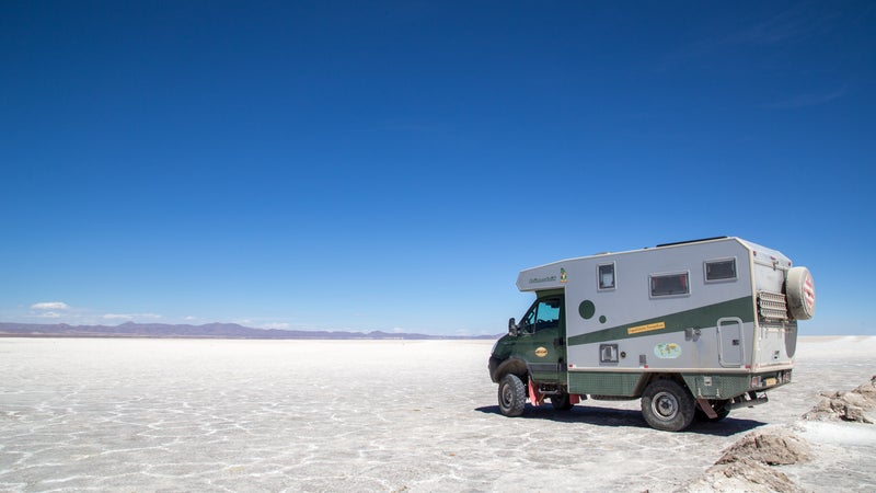 A truck and mounted camper in the desert