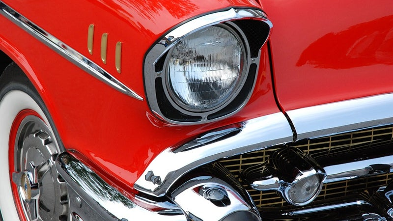 A classic car with red paint