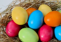 Multicolored Easter eggs in a basket