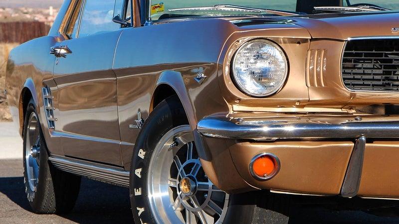 A vintage brown ford car