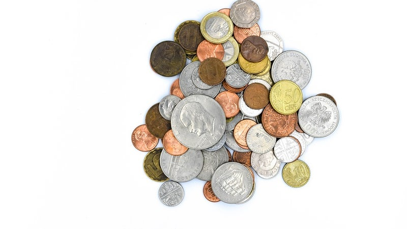 Coins in a pile on a white background