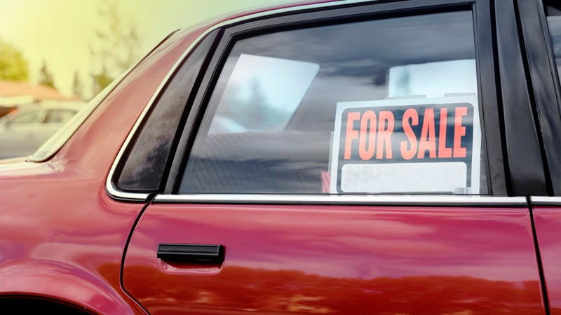 Car window with a for sale sign
