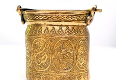 A bronze antique container with handles