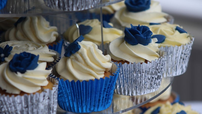Cupcakes with white frosting on a display