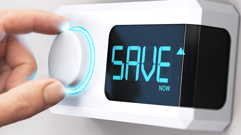 """A thermostat with the word """"save"""" on the digital display"""